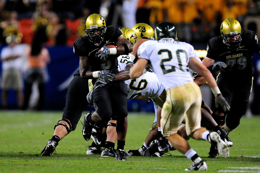 31 Aug 2008: Colorado tailback Demetrius Sumler advances the ball against Colorado State. The Colorado Buffaloes defeated the Colorado State Rams 38-17 at Invesco Field at Mile High in Denver, Colorado. FOR EDITORIAL USE ONLY