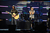 Washington, DC - January 19, 2009 -- Billy Ray Cyrus and his daughter Miley Cyrus perform at the ?Kids Inaugural: We Are the Future? concert at the Verizon Center in downtown Washington, D.C., Monday, January 19, 2009.  Michelle Obama, wife of President-elect Barack Obama, along with daughters Malia and Sasha, were in attendance. .Credit: Mark O'Donald - DoD via CNP
