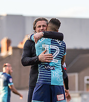 Wycombe Wanderers Manager Gareth Ainsworth embraces winning goalscorer Paris Cowan-Hall of Wycombe Wanderers during the Sky Bet League 2 match between Grimsby Town and Wycombe Wanderers at Blundell Park, Cleethorpes, England on 4 March 2017. Photo by Andy Rowland / PRiME Media Images.
