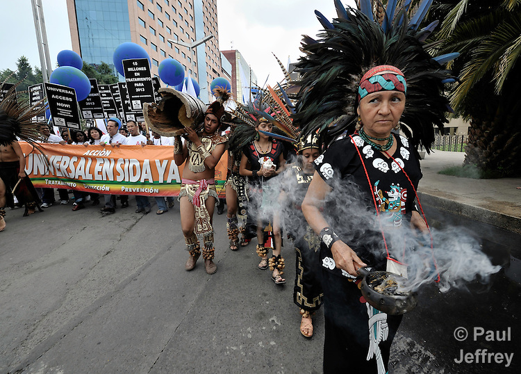 An indigenous woman burns incense as she leads the Universal AIDS Action Now! march through the streets of Mexico City on August 3, the opening day of the XVII International AIDS Conference. Participants called for an increase in testing, prevention, and treatment for HIV and AIDS.