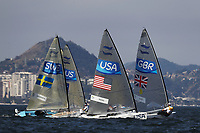 RIO DE JANEIRO, BRAZIL - AUGUST 16:  Max Salminen of Sweden, Caleb Paine of the United States and Giles Scott of Great Britain compete in the Men's Finn medal class race on Day 11 of the Rio 2016 Olympic Games at the Marina da Gloria on August 16, 2016 in Rio de Janeiro, Brazil.  (Photo by Clive Mason/Getty Images)