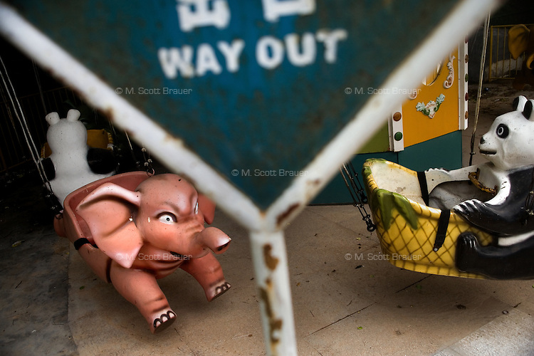 A merry-go-round with animal-shaped cars at the Qingdao Zoo in Qingdao, Shandong, China.