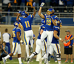 BROOKINGS, SD - OCTOBER 7: Marquise Lewis #11 and Jake Wieneke #19 from South Dakota State University celebrate a touchdown against Southern Illinois in the first half of their game Saturday night at Dana J. Dykhouse Stadium in Brookings. (Photo by Dave Eggen/Inertia)