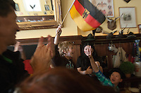 San Francisco, CA - Tuesday, July 8, 2014: German fans react to a goal in the second half against Brazil at Leopold's in San Francisco during a semi-final World Cup match.