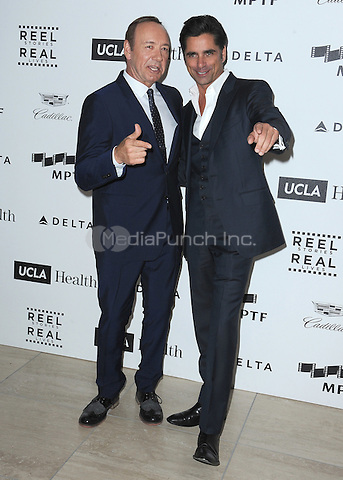 LOS ANGELES, CA - APRIL 25:  Kevin Spacey and John Stamos at the 4th Annual Reel Stories, Real Lives Benefit at Milk Studios on April 25, 2015 in Los Angeles, California. Credit: mpiPGSK/MediaPunch