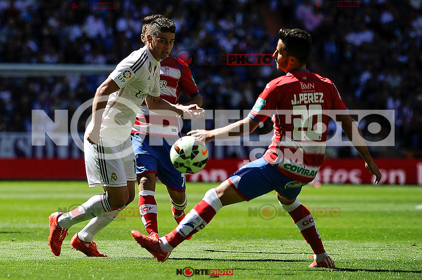 Real Madrid´s James Rodriguez and Granada´s Juan Carlos Perez during 2014-15 La Liga match between Real Madrid and Granada at Santiago Bernabeu stadium in Madrid, Spain. April 05, 2015. (ALTERPHOTOS/Luis Fernandez) /NORTEphoto.com