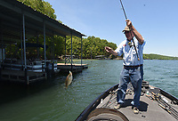 NWA Democrat-Gazette/FLIP PUTTHOFF <br /> Glenn snatches a crappie May 16 2019 from the shade of a dock. The fish hit a jig.