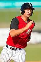Rangel Ravelo #24 of the Kannapolis Intimidators hustles towards third base against the Hickory Crawdads at CMC-Northeast Stadium on April 8, 2012 in Kannapolis, North Carolina.  The Intimidators defeated the Crawdads 12-11.  (Brian Westerholt/Four Seam Images)