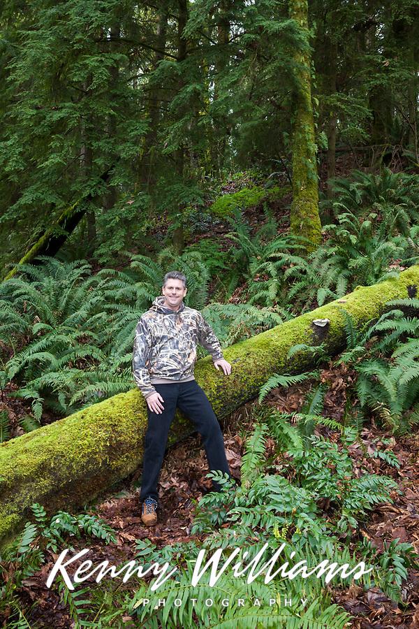 Photographer Kenny Williams Leaning Against Moss Covered Fallen Tree, Cascade Mountain Range, Washington, USA.