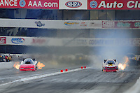 Nov. 11, 2011; Pomona, CA, USA; NHRA funny car driver Melanie Troxel (right) alongside Gary Densham during qualifying at the Auto Club Finals at Auto Club Raceway at Pomona. Mandatory Credit: Mark J. Rebilas-.