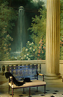 An 18th century Etruscan-style canape stands in front of a hand-painted waterfall scene in the rotunda