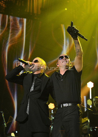 MIAMI, FL - NOVEMBER 5: Yandel and Pitbull at iHeartRadio Fiesta Latina 2016 at The American Airlines Arena on November 5, 2016. Credit: mpi04/MediaPunch