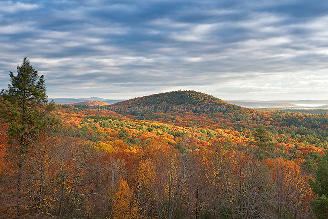 Rattlersnake Hill in Autumn at dawn with Mount Monadnock in the distance.