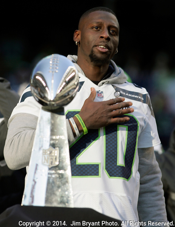 Seahawks cornerback Jeremy Lane (20) touches his heart in front of the Vince Lombardi Trophy during the Super Bowl XLVIII celebration at  CenturyLink Field on February 5, 2014 in Seattle. ©2014. Jim Bryant Photo. ALL RIGHTS RESERVED.