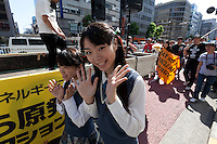 Members of the idol group, Seifuku Kojo Iinkai lead an anti nuclear protest march in Tokyo, Japan Sunday June 2nd 2013. The idol group have an anti-nuclear energy pop song.