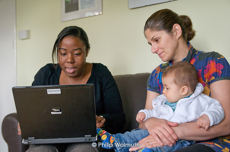 Job Centre Plus Parent Advisor Eniola Adegbuyi discusses employment and training opportunities with local parent Carla and her son Luca, at the Portman Early Childhood Centre, Paddington.  The advice session is part of the Westminster Works for Families programme.
