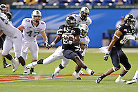 20 December 2011:  FIU running back Darriet Perry (28) attempts to break away from Marshall linebacker Devin Arrington (25) in the second quarter as the Marshall University Thundering Herd defeated the FIU Golden Panthers, 20-10, to win the Beef 'O'Brady's St. Petersburg Bowl at Tropicana Field in St. Petersburg, Florida.