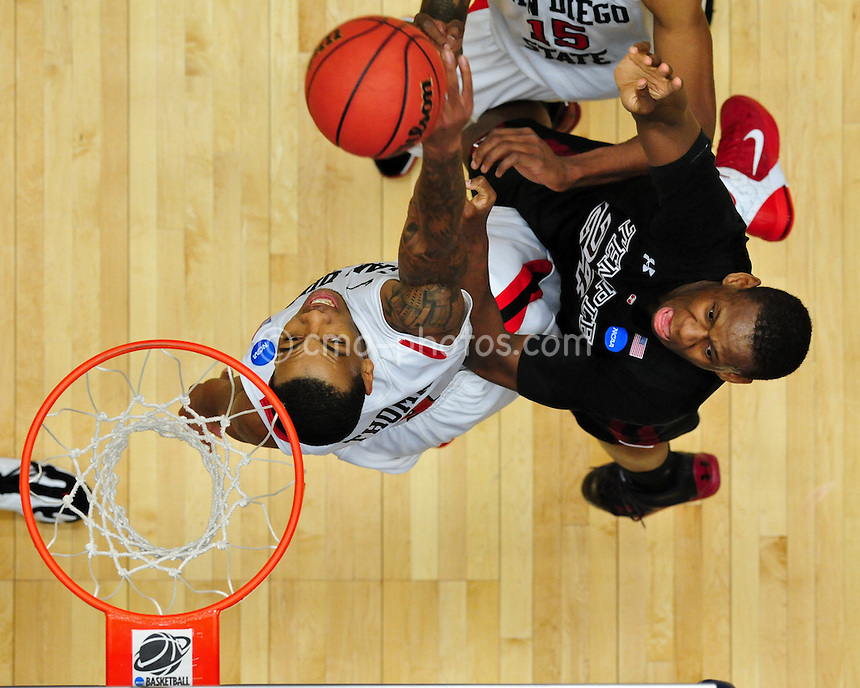 Mar 19, 2011; Tucson, AZ, USA; San Diego State Aztecs forward Malcolm Thomas (4) tries to block the shot of Temple Owls forward Lavoy Allen (24) in the second half of a game in the third round of the 2011 NCAA men's basketball tournament at the McKale Center.  The Badgers won 70-65.