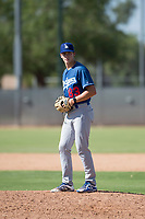 Los Angeles Dodgers relief pitcher Caleb Sampen (83) gets ready to deliver a pitch during an Instructional League game against the Milwaukee Brewers at Maryvale Baseball Park on September 24, 2018 in Phoenix, Arizona. (Zachary Lucy/Four Seam Images)