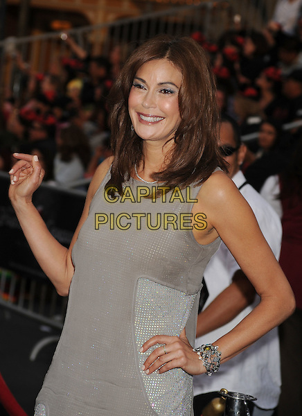 """TERI HATCHER.Premiere of """"Pirates of the Caribbean : On Stranger Tides"""" held at Disneyland in Anaheim, California, USA, May 7th 2011.4 four half length dress grey gray sleeveless hand on hip waving bracelet .CAP/ROT/TM.© TM/Roth/Capital Pictures"""