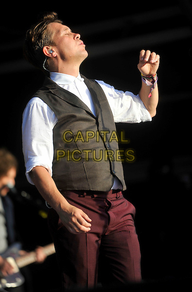 Mark Owen<br /> Camp Bestival, Lulworth Castle, Dorset, England.<br /> August 3rd 2013<br /> on stage in concert live gig performance performing half length maroon suit music waistcoat grey gray profile singing hands arms <br /> CAP/JIL<br /> &copy;Jill Mayhew/Capital Pictures