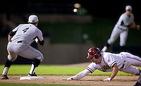 STANFORD, CA - March 25, 2011: Jake Stewart of Stanford baseball slides back to first in a pickoff attempt during Stanford's game against Long Beach State at Sunken Diamond. Stanford lost 6-3.