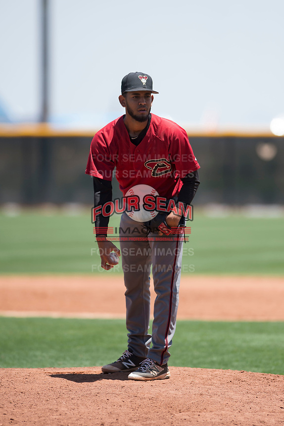 Arizona Diamondbacks relief pitcher Melvin Ovalles (12) looks to his catcher for the sign during an Extended Spring Training game against the Cleveland Indians at the Cleveland Indians Training Complex on May 27, 2018 in Goodyear, Arizona. (Zachary Lucy/Four Seam Images)