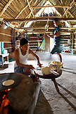 BELIZE, Punta Gorda, Toledo District, Cheratina Mes makes tortillas for lunch, San Jose Maya Village