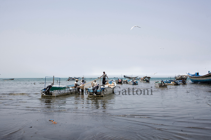 Yemen - Hudaydah - Fisherman fishing on the Red Sea. Yemen's economy depends heavily on oil production, and its government receives the vast majority of its revenue from oil taxes. Yet analysts predict that the country's petroleum output, which has declined over the last seven years, will fall to zero by 2017. The government has done little to plan for its post-oil future. Yemen's population, already the poorest on the Arabian peninsula and with an unemployment rate of 35%, is expected to double by 2035..The trends will exacerbate large and growing environmental problems, including the exhaustion of Yemen's groundwater resources. Given that a full 90% of the country's water is used for agriculture, this trend portends disaster..Sanaa's well are expected to dry out by 2015, partly due to illegal drilling, partly because 40% of the city's water is diverted for qat production, and partly because conservation rules are difficult to enforce. Only 20% of the houses receive water, the other 80% has to collect it from pumps and wells. 15% of the urban population only uses bottled water as its primary drinking water source and that is why Yemen has one of the highest world mortality rate, most of the diseases being related to water..