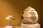 A Hupa basketry hat and Yurok basket with lid in the Beauty Within exhibit at the Museum of Indian Arts and Culture, Museum of New Mexico, Santa Fe, New Mexico