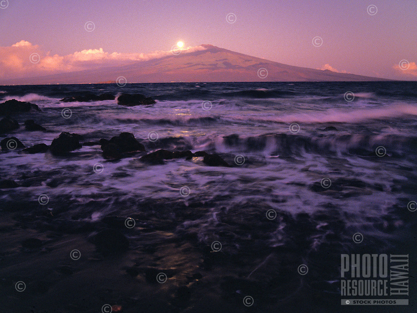 View of moon rising behind Haleakala, taken across the channel from the island of Kaho'olawe