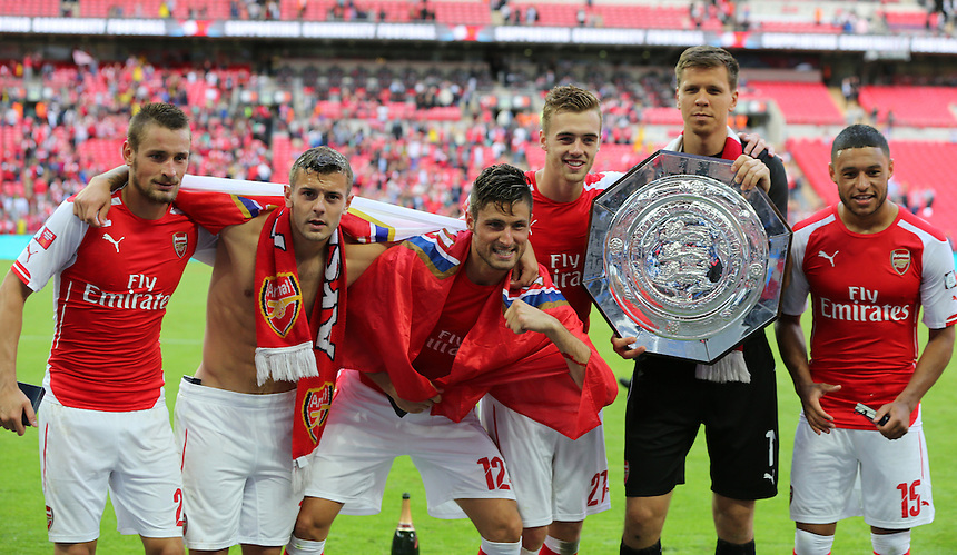 Arsenal's Mathieu Debuchy,Arsenal's Jack Wilshere,Arsenal's Olivier Giroud Arsenal's Calum Chambers, Arsenal's Wojciech Szcz?snyand Arsenal's Alex Oxlade-Chamberlain with the FA Community Shield<br /> Photographer Kieran Galvin/CameraSport<br /> <br /> Football Friendly - FA Community Shield - Arsenal v Manchester City - Sunday 10th August 2014 - Wembley - London<br /> <br /> &copy; CameraSport - 43 Linden Ave. Countesthorpe. Leicester. England. LE8 5PG - Tel: +44 (0) 116 277 4147 - admin@camerasport.com - www.camerasport.com