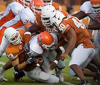 30 September 2006: Sam Houston State back D.D. Terry (#34) is tackled by a gang of Longhorns including Scott Derry (#33) and Robert Killebrew (#40) during the Bearkats 56-3 loss to the University of Texas Longhorns at Darrell K Royal Memorial Stadium in Austin, TX.