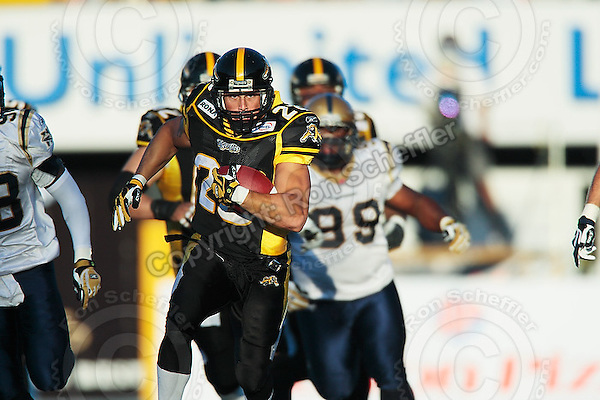 Aug 3, 2007; Hamilton, ON, CAN; Hamilton Tiger-Cats running back (28) Jesse Lumsden runs for a touchdown against the Winnipeg Blue Bombers during the first quarter at Ivor Wynne Stadium. The Tiger-Cats defeated the Blue Bombers 43-22. Mandatory Credit: Ron Scheffler
