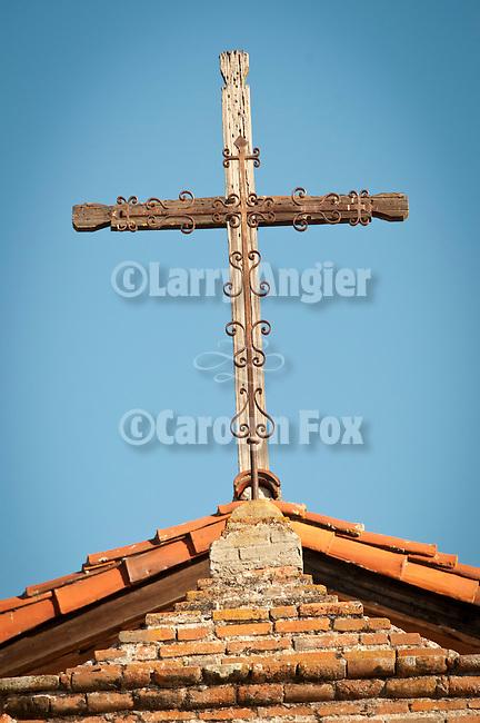 Rustic cross over the chapel entrance, Mission San Antonio de Padua, California.