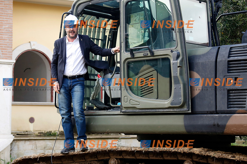 Matteo Salvini wearing an helmet, enters the scraper to start the demolition<br /> Matteo Salvini con il caschetto entra nella ruspa per dare avvio alla demolizione<br /> Roma 26/11/2018. Demolizione di una villa del clan malavitoso della famiglia Casamonica alla Romanina, Roma est. I Casamonica sono associati al crimine nella periferia sud est di Roma.<br /> Rome November 26th 2018. Another Casamonica mobster clan villa being demolished. Army started the demolition of an illegally built villa belonging to members of the Casamonica criminal clan.  The Casamonica family has been associated with crime in the south-eastern quarters of Rome for several decades.<br /> Foto Samantha Zucchi Insidefoto