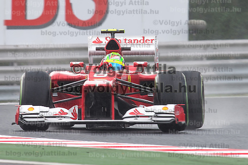 Ferrari Formula One driver Felipe Massa drives his car during a free practice session during the Hungarian F1 Grand Prix in Mogyorod (about 20km north-east from Budapest), Hungary. Friday, 27. July 2012. ATTILA VOLGYI