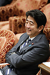 February 12, 2013, Tokyo, Japan - Japan's Prime Minister Shinzo Abe smiles as he listens to questions from an opposition lawmaker during a question-and-answer session of the Diet lower house Budget Committee in Tokyo on Tuesday, February 12, 2013. (Photo by AFLO)