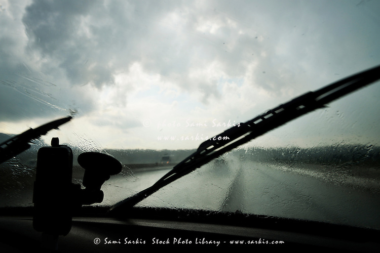 Car windshield by heavy rains on highway, Brignoles, France