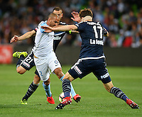 Melbourne, 17 December 2016 - EMMANUEL MUSCAT (2) of Melbourne City and JAMES DONACHIE (17) of the Victory fight for the ball in the round 11 match of the A-League between Melbourne City and Melbourne Victory at AAMI Park, Melbourne, Australia. Victory won 2-1 (Photo Sydney Low / sydlow.com)