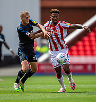 27th June 2020; Bet365 Stadium, Stoke, Staffordshire, England; English Championship Football, Stoke City versus Middlesbrough; George Saville of Middlesbrough tackles Tyrese Campbell of Stoke City
