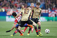Atletico de Madrid´s Diego Costa (L) and Milan´s Adil Rami and Andrea Poli during 16th Champions League soccer match at Vicente Calderon stadium in Madrid, Spain. March 11, 2014. (ALTERPHOTOS/Victor Blanco)