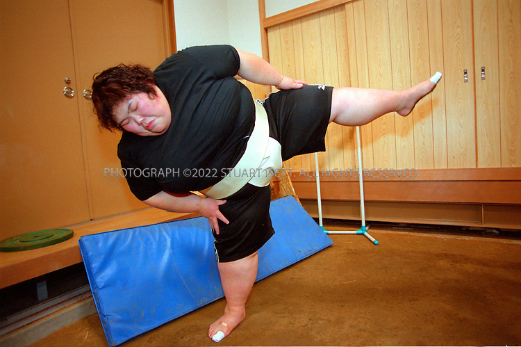 10/26/2001--Osaka, Japan..Rie Tsuihiji, 23, Japan's leading female sumo wrestler and 2000 world champion, warms up before practise at her company's sumo club. With no other large women in the club, Tsuihiji is forced to practise with other men...All photographs ©2003 Stuart Isett.All rights reserved.This image may not be reproduced without expressed written permission from Stuart Isett.