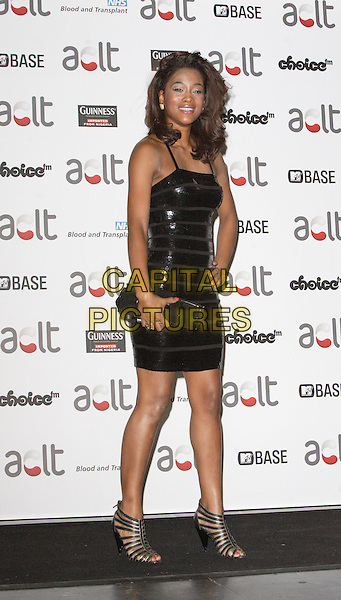 TIANA BENJAMIN .Afro Caribbean Leukaemia Trust Gift Of Life Ball at the Inter-Continental Hotel, Park Lane, London, England, September 20th 2008..full length black strapless dress shiny shoes sandals hand on hip clutch bag .CAP/ROS.©Steve Ross/Capital Pictures