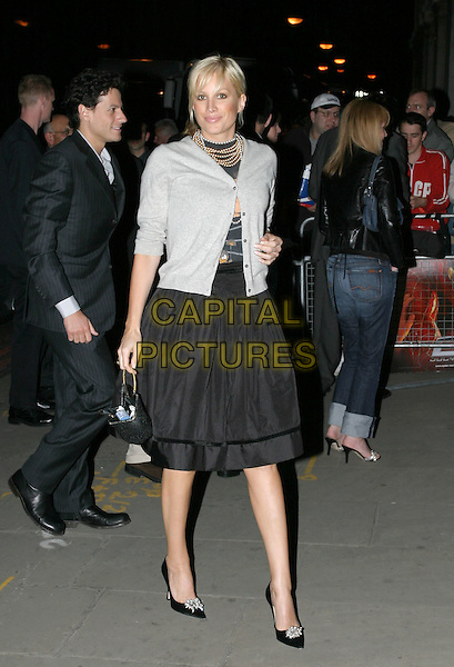 """ALICE EVANS.arrivals at """"Spiderman 2"""" film premiere party.at Old Billingsgate Market.london 12 July 2004.full length cardigan pearl necklace, balck skirt, shoes, open, look closer.www.capitalpictures.com.sales@capitalpictures.com.© Capital Pictures."""