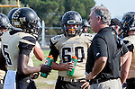 Palos Verdes, CA 10/25/13 - Michael Christensen (Peninsula Head Coach), Carlo Merola (Peninsula #60) and Tobi Ibraheem (Peninsula #5) in action during the Mira Costa vs Peninsula varsity football game at Palos Verdes Peninsula High School. in action during the Mira Costa vs Peninsula varsity football game at Palos Verdes Peninsula High School.