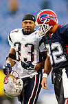 New England Patriots runningback Kevin Faulk (33) chats with Buffalo wide receiver Josh Reed (82) after a game against the Buffalo Bills at Ralph Wilson Stadium in Orchard Park, NY, on December 11, 2005 . The Patriots defeated the Bills 35-7. Mandatory Photo Credit: Ed Wolfstein