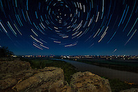Star trails over the Arkansas River from Petit Jean State Park.