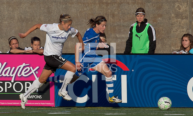 Boston Breakers midfielder Liz Bogus (7) dribbles as magicJack defender Marian Dalmy (2) defends. In a Women's Professional Soccer (WPS) match, the Boston Breakers defeated magicJack, 2-1, at Harvard Stadium on June 5, 2011.