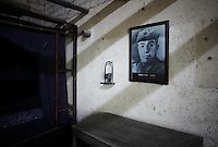 A picture of Mao Zeming, Mao Zedong's younger brother, hangs in Zeming's bedroom at their former home and birthplace in Shaoshan, Hunan Province, China on 12 August 2009.
